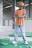 16043407-young-boy-standing-next-to-a-basket-of-golf-balls-holding-a-golf-club-at-a-golf-course